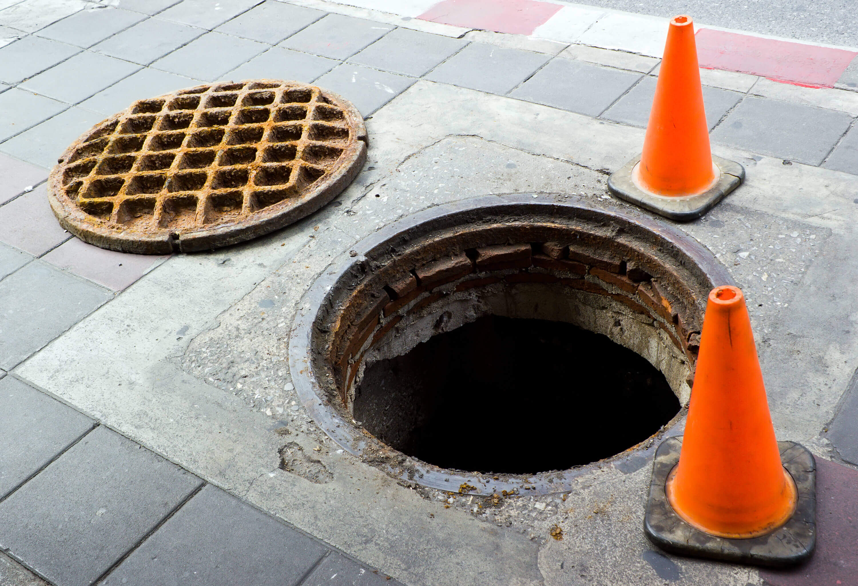 Open manhole and cones