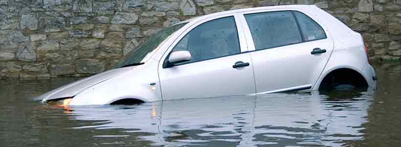 Car floating in submerged flood water